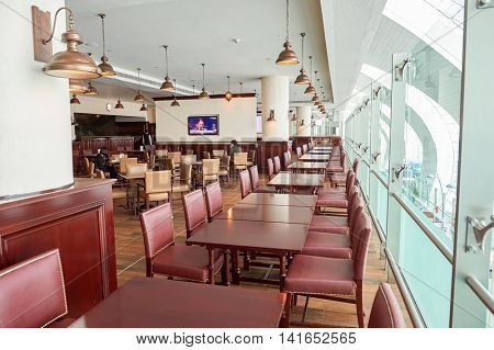 DUBAI, UAE - MARCH 10, 2015: inside of Dubai International Airport. Dubai International Airport is the primary airport serving Dubai, United Arab Emirates.