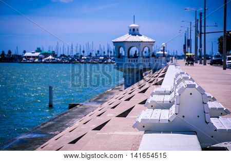 Corpus Christi Texas Coastal City on the gulf of mexico with deep perspective of sea wall , benches , and gazebo