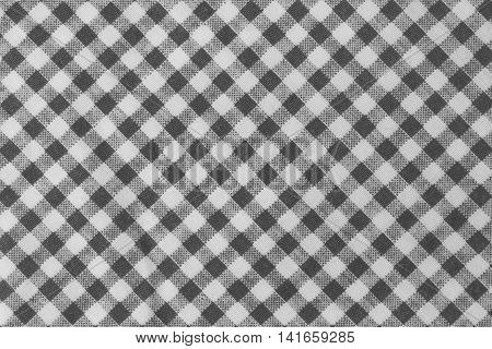Fabric Texture Close Up of Black and White Lumberjack Plaid Towel or Napkin Pattern Background.