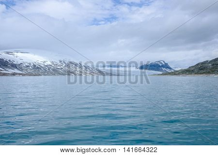 Scenic view of Styggevatnet with snowy mountains on the background. Norway.