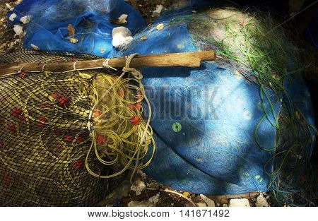 fishing net left to dry on the ground