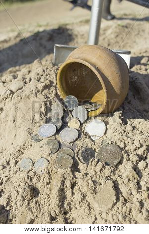Treasures of ancient coins dug out of the ground.
