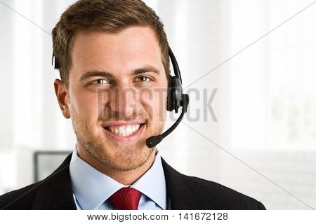 Portrait of an handsome man wearing an headset
