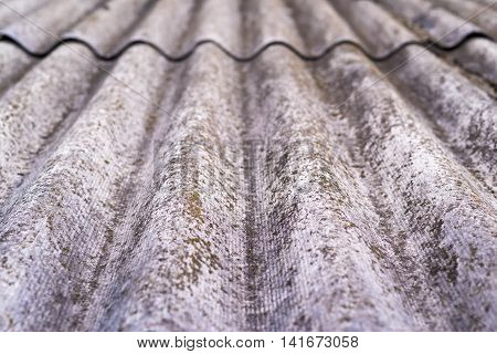 the abstract textured background closeup of wavy asbestos-cement slate of gray color