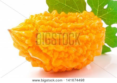 yellow momordica with leaf isolated on white background.