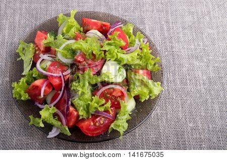 Top View On A Plate With Fresh Salad Of Raw Vegetables
