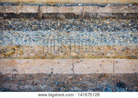 Layers soil and rock of traffic road Layer soil paving Layer of crush rock.