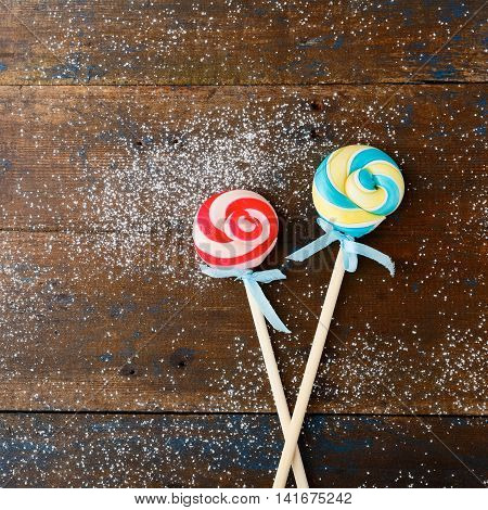 Lollipop On A Wooden Background