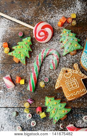 Christmas Ginger Cookies, Cane, Lollipop And Sweet Candy Strewn With Snow