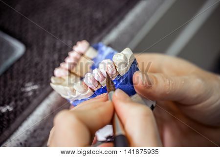 Dental technician working in dental laboratory, dental concept