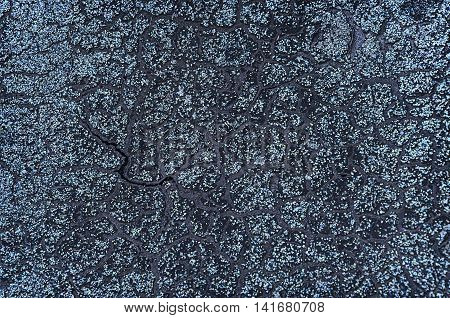 Background of the roofing material with the resin. Close-up photo of old ruberoid. texture .