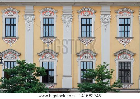 Beautiful Building With Arched Windows And A Bas-relief. Poland
