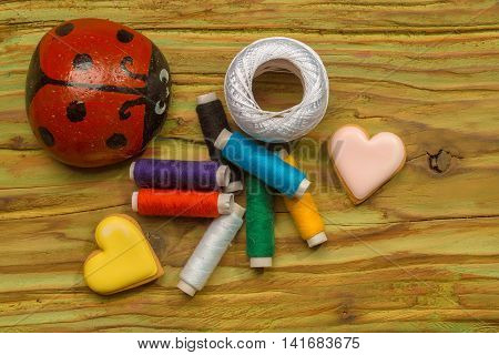 Bobbins Of Thread With Decorative Hearts And Ladybug