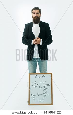 young handsome bearded man scientist or professor with long beard holding teacher board with einstein formula and newtons law isolated on white background