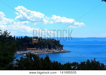 Seaside view in Grignano near Trieste with blue sky sea and lots of yachts