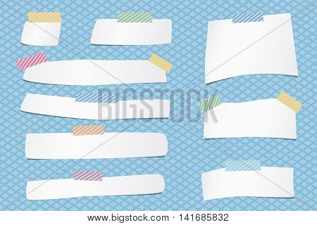 Pieces of cut white note paper are stuck with colorful striped sticky tape on grid pattern.