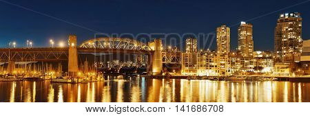 Vancouver False Creek at night with bridge and boat panorama.