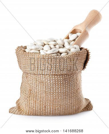 Butter beans or lima beans with wooden scoop in a burlap bag  isolated on white background. Dry white beans in burlap sack. Beans