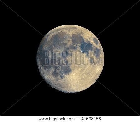 Full moon seen with an astronomical telescope with enhanced colours to show the real colours of terrain surface