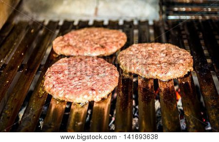 Grilling Burgers On Barbecue Bbq Grill On Hot Charcoal.