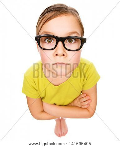 Little girl wearing glasses, bad eyesight concept, fisheye portrait, isolated over white