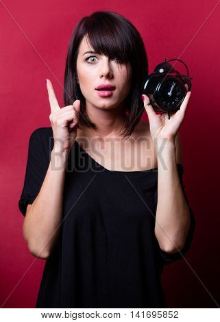 Young Woman With Alarm Clock