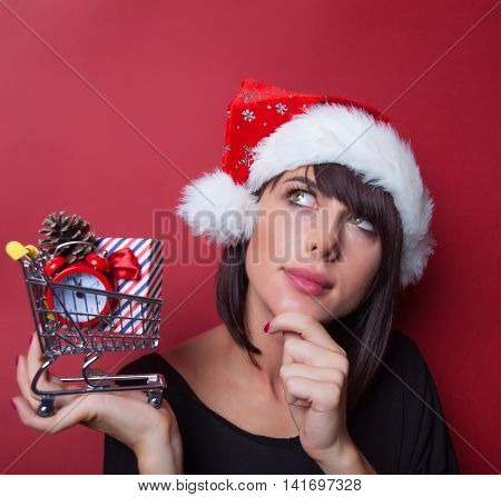 Young Woman With Shopping Cart And Gift