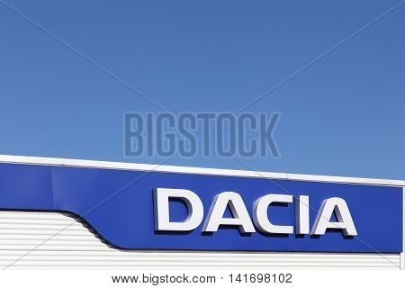 Villefranche, France - July 3, 2016: Dacia logo on wall of a dealer. Dacia is a Romanian car manufacturer and belong to Renault group