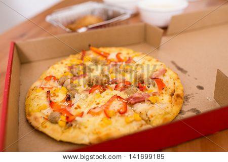 Fresh pizza in open box