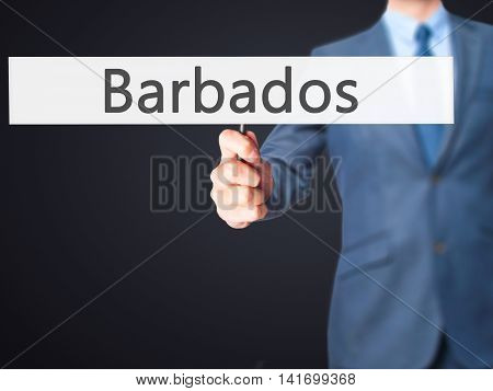 Barbados - Business Man Showing Sign