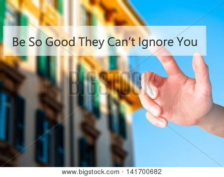 Be So Good They Can't Ignore You - Hand Pressing A Button On Blurred Background Concept On Visual Sc