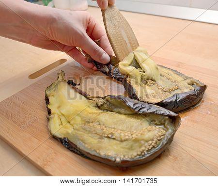 unskin roasted eggplants for salad, close up