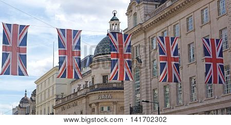 LONDON, UK - JULY 25: A string of Union Jack flags hangs across Regent Street near London's Piccadilly Circus on July 25, 2016.