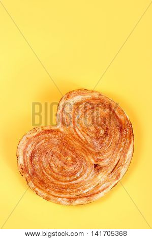 Sweet Puff Pastry On Yellow Background - Palmeras