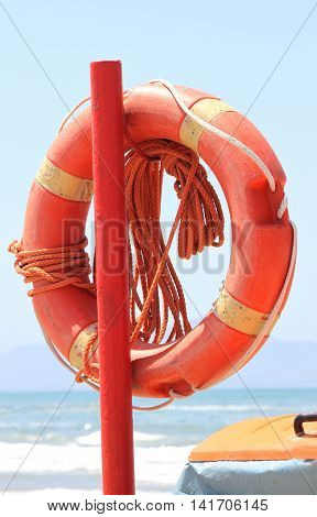lifebuoy to save peopleon beach on blue sea background