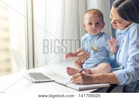 Business Lady With Her Baby