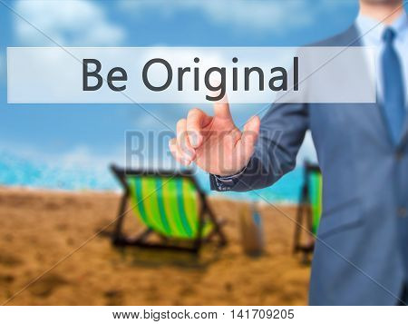 Be Original - Businessman Hand Pressing Button On Touch Screen Interface.