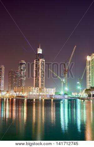 DUBAI, UAE - OCTOBER 15, 2014: view of Burj Khalifa Lake in Dubai at night. Dubai is the most populous city in the United Arab Emirates