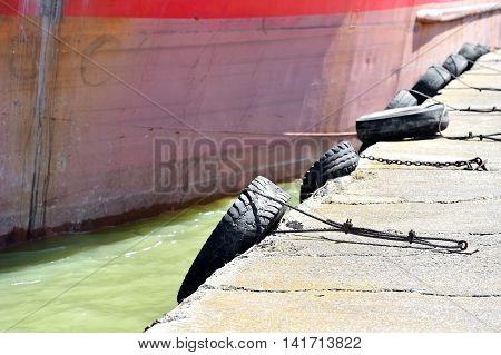 Several bumper tyres on a pontoon bridge