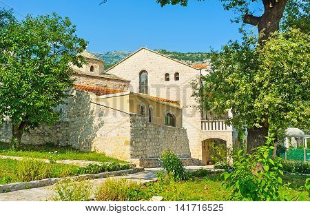 The rebuilt complex of the former monastery surrounds preserved St Petka Church in Budva Montenegro.