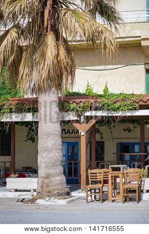 PALEOCHORA, CRETE, GREECE - MAY 03. Taverns and Restaurants at the beach promenade in Paleochora, a nice village in the south west of Crete on May 03, 2016. Backpacker use this village as starting point