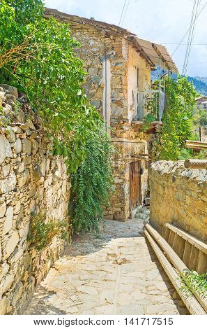 The village in Troodos mountains has stone houses fences and roads preserved since old times Gourri Cyprus.