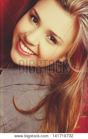 Close up of a beautiful smiling young woman