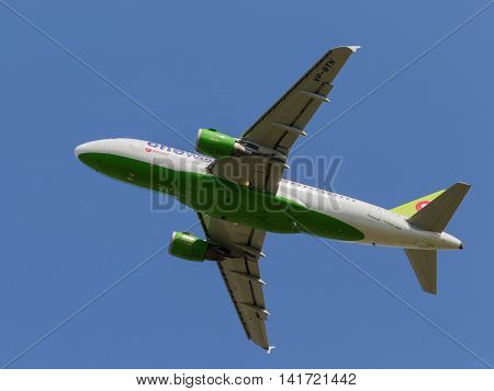 Moscow region - July 31 2016: White-green passenger aircraft Airbus A-319-114 S7 Airlines flies to Moscow's Domodedovo airport July 31 2016 Moscow Region Russia