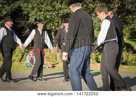Men Dance Round In A Show
