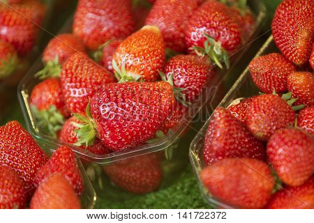 close up of strawberries at fruit stand