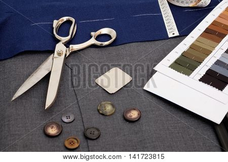 Collection of tailor tools isolated on textile background