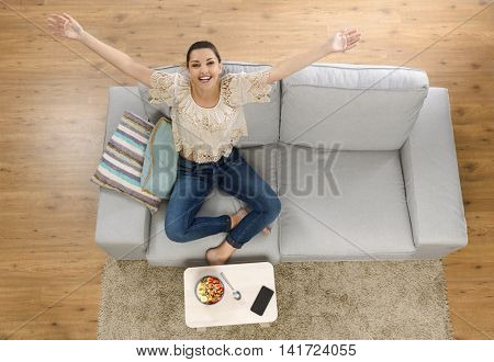 Top view of a beautiful woman at home