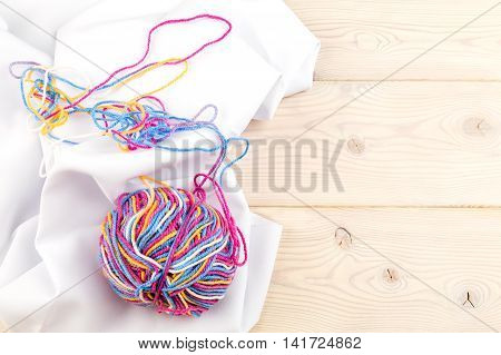 Multicolor Bundle On White Fabric