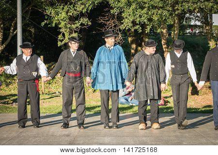 Men Dance In Typical Costume
